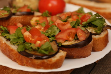Bruschetta with grilled eggplant and vegetables on ciabatta