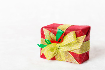 Red Christmas gift box on white background.