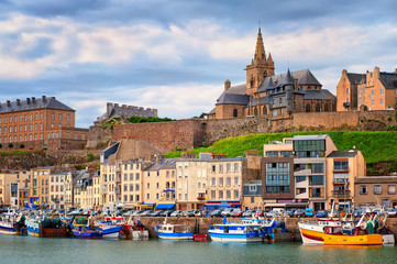 Gothic church on the hill and fishermen boats in port town Granv Fototapete