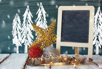 image of christmas decorations and chalkboard next to blackboard background with winter concept drawings
