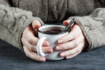 Woman's hands holding the cup of tea
