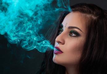 Woman blowing smoke, smoking a cigarette