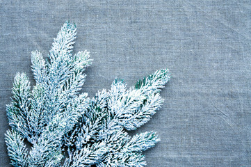 Christmas template framework with snow pine branch on linen background