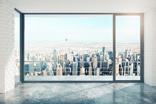 Empty loft room with big window in floor and city view