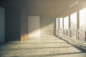 Modern loft style empty room with windows in floor at sunrise