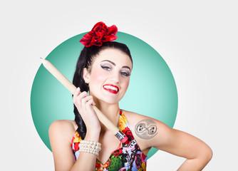 Beautiful pin-up girl getting skull tattoo stencil
