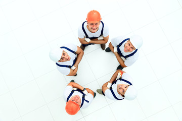 Large group of workers standing in circle