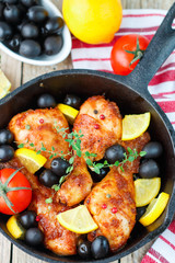 Fried chicken. Fried chicken legs with lemon and olives