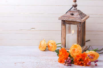 Autumn backgroud with flowers   in yellow colors and candle in l