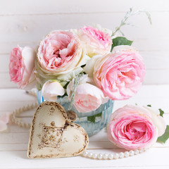 Background with sweet pink roses flowers  in blue vase and decor