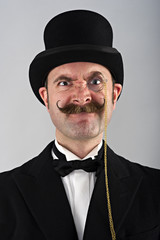Charicature portrait of man in top hat and monocle