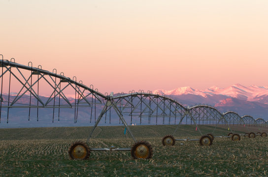 Pivot Irrigation System with Mountain Range in background