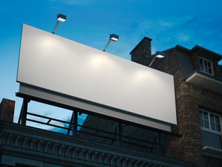 Blank billboard standing on classic building in the night