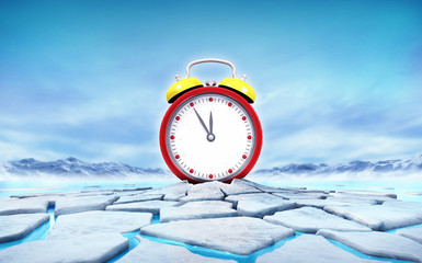 red alarm clock in the middle of ice floe cracked hole