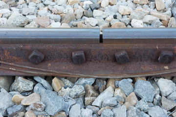 old rusted screw on railroad. rusty metal rail track fixed on st