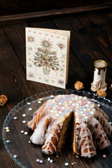 Kugelhopf cake on the wooden table.