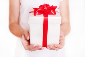 Woman holding a gift box. Time gifts.