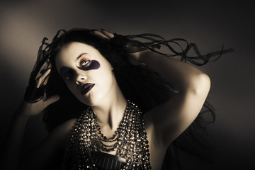 Young grunge fashion girl. Wavy dark hair style