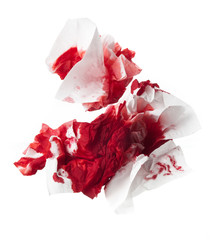Blood in tissue paper on a white background