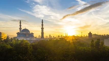 Poster Kuala Lumpur Sunrise at Federal Mosque Kuala Lumpur, with silhouette city skyline