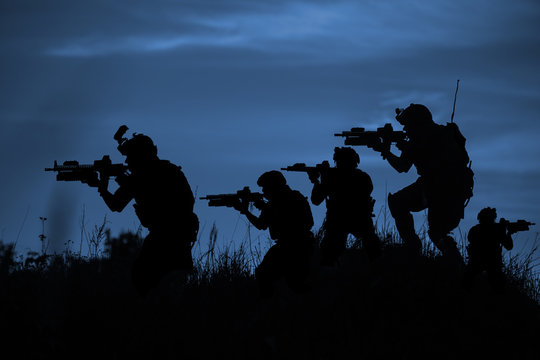 Silhouette of soldier with rifle..