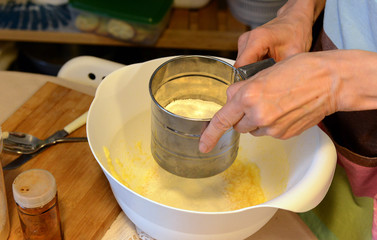 cooking and home concept - close up of female hands kneading dough at home