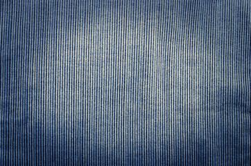Blue corduroy fabric texture close- up photo background.