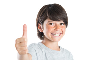 Boy smiling with thumb up