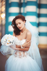 young bride with bouquet