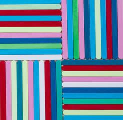 Colorful striped background. Plastique sticks of different color