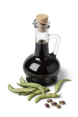 Bottle with soy sauce and fresh soybeans