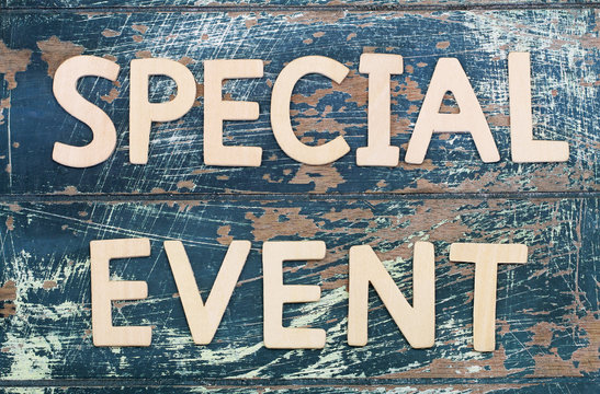 Special event written with wooden letters on rustic surface