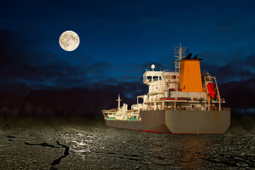 Frozen sea and tanker ship at night.