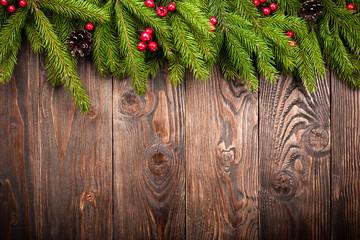 Fir tree on dark wooden background