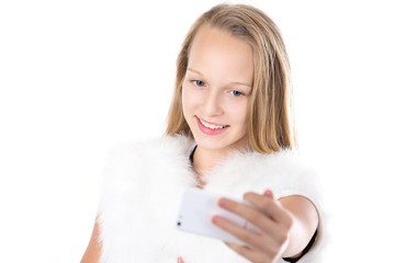 Portrait of happy girl taking selfie