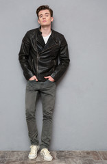 Full length portrait of a casual man in leather jacket