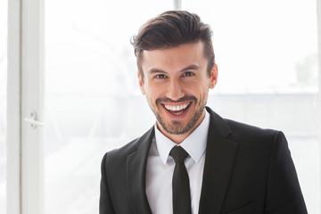 Handsome man wearing classic black business suit