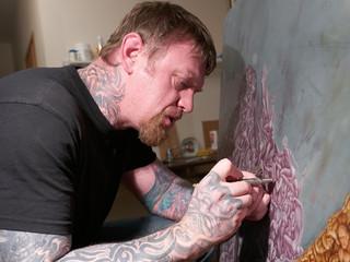 Portrait of painter airbrusher in art studio