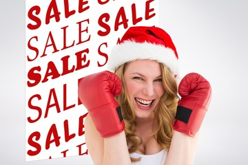 Composite image of blonde wearing boxing gloves