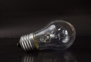 incandescent light bulb black background
