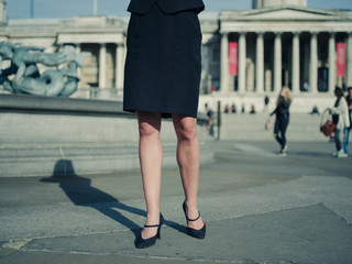 Businesswoman in city on sunny day
