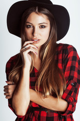 young pretty brunette girl hipster in hat on white background casual close up dreaming
