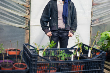 Woman standing outside greenhouse