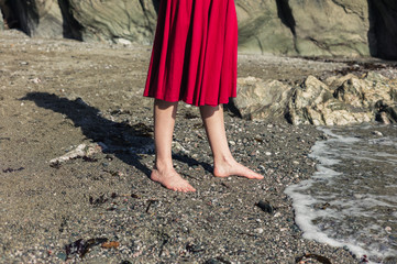 Feet of woman walking on the beach