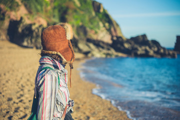 Young woman with furry hat on beach