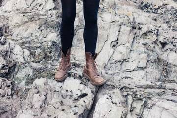 Woman in hiking boots standing on rocks