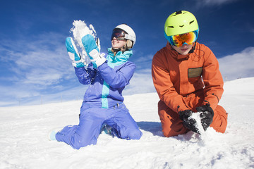 Picture of two snowboarders having fun on the top of Dolomiti Alps
