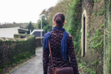 Woman walking in street of village