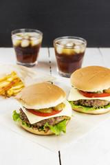 Mini burger - meat, tomato, gherkin, lettuce, onions on a roll w