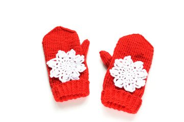 Red knitted mittens with snowflakes